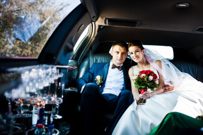 wedding couple in the limousine